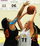 LON AUSTIN/CENTRAL OREGONIAN - Gracie Kasberger goes up for a shot in a recent summer basketball game against Culver. The Cowgirls are scheduled to play 15 summer games and attend a team camp this summer.