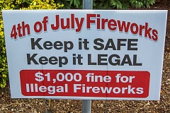 NEWS-TIMES PHOTO: TRAVIS LOOSE - Forest Grove Fire & Rescue would like residents to come pick up these free signs and stick them in their front lawns. Or call and a FGF&R representative will deliver one to you.