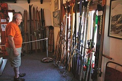 POST PHOTO: KYLIE WRAY - Curator Lloyd Musser surveys the museums historical ski equipment in the ski gallery.