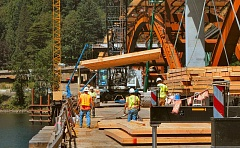 DAVID F. ASHTON - A wooden concrete form, used to shape the new Sellwood Bridges deck, is hoisted from the work bridge.