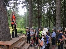 SUBMITTED PHOTO - Teens wait for instruction at a Tree to Tree ropes course. The city's teen programs are full for the summer.