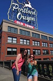 TRIBUNE PHOTO: JOSEPH GALLIVAN - Candace Woods and Katrina Woods (in pink), teachers from Philadelphia, take a selfie with the Portland, Oregon sign in the background.