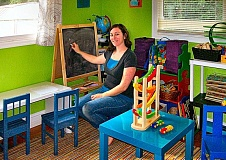 RITA A. LEONARD - Owner-teacher Jackie Gelber, shown with Art easel and play stations, at her new Springwater Playschool in Ardenwald.