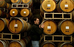 TRIBUNE FILE PHOTO  - At Sokol Blosser Winery in Dayton, Ore., climate change is not just an environmental issue, it's a business issue. Alex Blosser, shown here, helps run the family-owned winery.