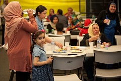 TIMES PHOTO: DIEGO DIAZ - Men and women from across Portland gathered in Tigard this week for iftar, a weekly dinner held at Muslim Educational Trust during Ramadan. For 30 days, Muslims refuse all food and water during the day, then celebrate with a feast after sunset.