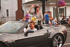 POST PHOTO: KYLIE WRAY - Sandy Mountain Festival Five Generation Court Queen Eileen Suchanek waves to spectators during the parade Thursday, July 9.