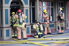 NEWS-TIMES PHOTO: MICHAEL SPROLES - Firefighters from Forest Grove, Cornelius, Hillsboro and Gaston responded to a fire alarm around 2:15 p.m. Wednesday, July 15, in downtown Forest Grove. Smoldering wood caused smoke to fill the space at 2036 Main St., Suite B, and billow outside.