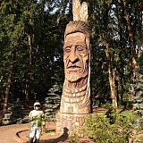 COURTESY PHOTO - A TeamStrange member pauses in front of the carved Native American statue in Hillsboros Shute Park. Motorcyclists are taking part in a cross-country tour focusing on Whispering Giants, the giant Indian heads carved by Hungarian artist Peter Wolf Toth.