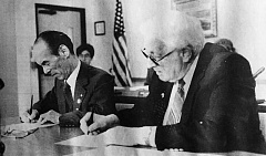SPOKESMAN FILE PHOTO - Mayors Yoichiro Iino and Bill Stark sign the sister city agreement in Council Chambers on Monday, October 17, 1988.