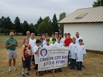 SUBMITTED PHOTO - Boy Scout Troop #140 gathers with Elks members to celebrate the completion of one painting project.