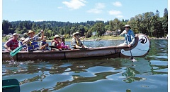 SUBMITTED PHOTO - Paddlers head down the Willamette River in canoes furnished by the Lower Columbia Estuary Partnership on their way to downtown Milwaukie in last years NCUWC-sponsored event.