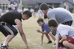 PHIL HAWKINS - Since its inaugural year during the summer of 2013, the Woodburn youth football camp has grown from just a more than a dozen participants to nearly 100 kids.