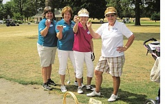 SUBMITTED PHOTO - Pictured on one of the sand greens are (from left) guest day chairwoman Alicia Stinnett, club president Dianne Ferschweiler, and guests Sherry Manier and Joanne Delnick.