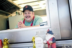 TIMES PHOTO: JONATHAN HOUSE - John Robinson, owner of the Batter Up! waffle cart at The Eating Place at Aloha Mall food cart pod, is pleased that Beaverton soon will allow similar groups of mobile restaurants.