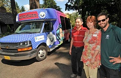 REVIEW PHOTO: VERN UYETAKE - Driver Jim Liu (from left), Adult Community Center Manager Ann Adrian and graphic artist Dave Arpin check out AAC's new shuttle bus.