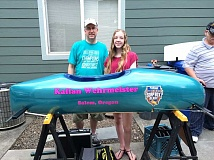 SUBMITTED PHOTO - Kallan Wehrmeister and her dad, Mark, work on her Soap Box Derby car before heading to Akron, Ohio, for the world championships.