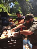 SUBMITTED PHOTO - A big barbecue on the Fourth of July was used to celebrate a remarkable first year for Lake Oswego VFW Post 12140. Manning the grill are Sean Ohara (left) and Tony Allen.