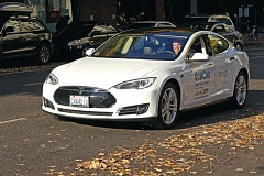 TRIBUNE PHOTO: JAIME VALDEZ  - Ron Knori drives one of his Tesla Model S cars. Despite market upheaval caused by the arrival of Uber and Lyft, he launched his new EcoCab service in Portland on Wednesday, July 22.