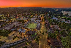 CLIFFORD PAGUIO PHOTOGRAPHY - Sunset over Lake Oswego, looking north toward Portland and with Mount St. Helens in the distance.
