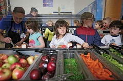 TRIBUNE FILE PHOTO: JONATHAN HOUSE  - Students at Kelly Elementary School in Southeast Portland grab their salad bar favorites. The new state bill eliminates the reduced price lunch category to let needy children eat for free.