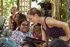 Kaely Summers, who runs the Forest Grove Farmers Market for Adelante Mujeres, reads a Gary Larson book called Theres A Hair In My Dirt to Adelante Chicas summer campers during a recent event at Nana Cardoon, a one-acre farm in Forest Grove.