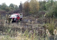 SUBMITTED PHOTO - A Tualatin Valley Fire & Rescue brush rig sits among some of the ground that burned during a Monday fire near the Tigard Sand & Gravel Quarry in Tualatin.