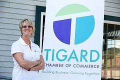 TIMES PHOTO: JONATHAN HOUSE - Tigard Chamber of Commerce CEO Debi Mollahan poses with the Chamber's new logo.