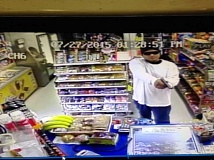 COURTESY PHOTO - A surveillance camera caught this image of a man who robbed the Lucky Market in Forest Grove at gunpoint Monday afternoon.