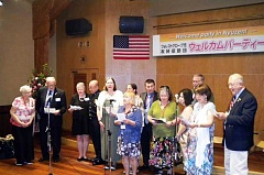 COURTESY PHOTOS - During the week-long trip to Japan July 20-26, a banquet honoring the Forest Grove Sister City delegation their host families took place at the Nyuzen Community Center. Here, delegates sing to the people of Nyuzen in Japanese