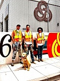 RITA A. LEONARD - The painters of TriMets new Holgate mural, from Fontana Studios, left to right: Zach Yarrington, with his dog, Victor; Blaine Fontana; and David Rice. Not shown is Gage Hamilton, who also participated.