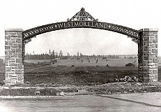 Courtesy of Dana Beck and the SMILE History Committee, this photo, taken when the Westmoreland district was just being laid out, shows mostly pastureland. There are two different stories as to where this arch, erected in 1909, was placed, but both agree we are looking east across Milwaukie Road here. One says we are looking east along what would become ByBee - but, it seems to us, the track of this road would already have been better established than this. The story other puts it a block north, near todays LoLos Westmoreland Barber Shop and Fat Alberts Restaurant. If that story is right, those faint markers may show where Glenwood Street was supposed to be - but now is not.