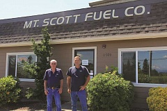 POST PHOTO: ALEXANDRA WALLACHY - Terry and Paul Tyler stand outside the Boring location of Mt. Scott Fuel Co.