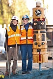 COURTESY: TRIMET/FRED JOE - Artists Hilary Pfeifer and TriMets Mary Priester at the installation of the totem Pfeifer carved.
