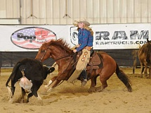 PHOTO COURTESY OF SHAWN JOHNSON - Colton's Makayla Johnson and her horse Bennie work to keep a cow separated from the herd during the girls' cutting competition at the 2015 National High School Finals Rodeo in Rock Springs, Wyo.