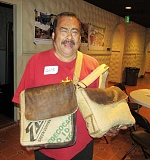 OUTLOOK PHOTO: JODI WEINBERGER - Gus Campos shows off his hand-sewn bags at a business networking event.