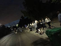 SUBMITTED PHOTO - Concerned neighbors walk the route from the Oak Grove Daycare at night on July 22.