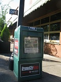 PHOTO BY: RAYMOND RENDLEMAN - Oregon City officials acknowledged that they had made a mistake in removing 10 newspaper stands from city streets on July 31, all of which the city returned last week, including this Oregon City News box in front of Singer Hill Cafe.