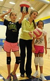 LON AUSTIN/CENTRAL OREGONIAN - Mallory Hall (center) helps teach serving to Ellie Owen (left) and  Abbi Pack during this week's Rimrock Volleyball Camp, which was held at Crook County High School.