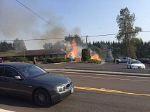 CLACKAMAS FIRE DEPARTMENT - A brush fire quickly spread to a commercial building, damaging two businesses.