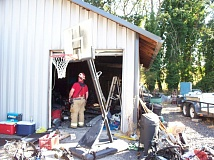 COURTESY OF COLUMBIA RIVER FIRE & RESCUE - A firefighter stands in the doorway to a Railroad Avenue storage shed where there was a fire Wednesday morning, Aug. 19.
