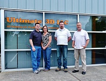 COURTESY PHOTO - Robin and Patty Oeffner, Tom Engle and Mike Larkin of Ultimate 3D stand outside the company's offices on Southeast Alexander St. in Hillsboro. The business opened in December 2014.
