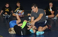 LON AUSTIN/CENTRAL OREGONIAN - Ahad Javansalehi helps Mitch Warren with his technique on a cradle during the final day of the Lion of Lions Wrestling Camp, which was held at Crook County High School. Javansalehi wrestled in both the 1988 and 1992 Olympics for Iran and is currently an assistant coach on the USA National Team.
