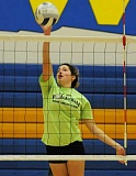 LON AUSTIN/CENTRAL OREGONIAN - Laura Fraser hits a ball during the first week of practice Tuesday morning. Fraser is one of seven juniors on this year's CCHS volleyball team, and all have varsity experience.