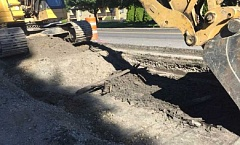 PHOTO COURTESY OF JAHMAI CHERRY, CITY OF BEAVERTON - Crews widening Southwest Farmington Road in Beaverton recently uncovered planks of wood that were the earliest form of paving on roadways in early farming communities west of Portland.