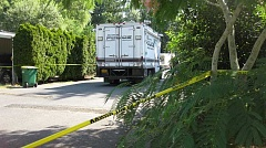 TIMES PHOTO: ERIC APALATEGUI - Police taped off part of the HIdden Village Mobile Estates during an investigation after officers returned fire at Michael Westrich, who police said injured fellow officer Scott Burke with a shotgun July 8. Westrich died and Burke recovered and returned to patrol duties.