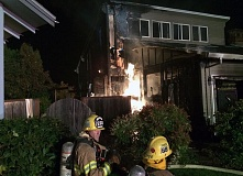 SUBMITTED PHOTO - TVF&R firefighters work to battle a fire that broke out early Tuesday morning at a two-story home in the Oak Hills neighborhood north of Beaverton.