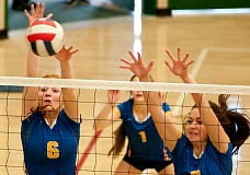LON AUSTIN/CENTRAL OREGONIAN - Jennifer McCallister and Cassidy Dill go up to block a spike during the Summit Jamboree last Friday. The Cowgirls were one of three teams to finish the jamboree with perfect 4-0 records.