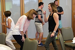 TIMES PHOTO: JAIME VALDEZ - Maureen Case, an instructional assistant at Bonny Slope Elementary School, shares a laugh with Kate Moehl, second-grade teacher at the school, after attempting to do Patty Cake spelling during an exercise being taught by Scott Williams at Village Baptist Church.