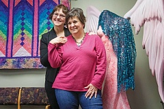 TIMES PHOTO: JONATHAN HOUSE - Sharon Henifin and Becky Olson of Breast Friends in Tigard. The organization is slowly expanding across the country, helping thousands of women battling cancer each year.