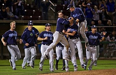 COURTESY: CRAIG MITCHELLDYER - Hillsboro Hops players head to the mound to celebrate their repeat Northwest League championship Sunday night. The Hops beat the Tri-City Dust Devils 6-1 to take the NWL title series 2 games to 1.